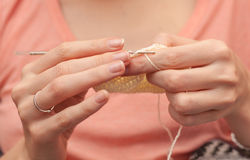 Close up of hands crocheting with wool. Selective focus Stock Photos
