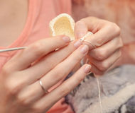 Close up of hands crocheting with wool. Selective focus Royalty Free Stock Photo