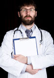 Close-up hands of a doctor, he takes notes in a patient's medical history Royalty Free Stock Photo