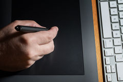 Close-Up Of Hands Drawing On Graphic Tablet Stock Photo