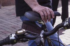 Close-up of the hands of an elderly man on a Bicycle. stock images