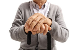 Close-up of hands of an elderly man on walking cane Stock Photos