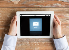 Close up of hands with email message on tablet pc Royalty Free Stock Photography