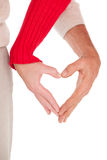 Close up of hands forming heart Royalty Free Stock Image