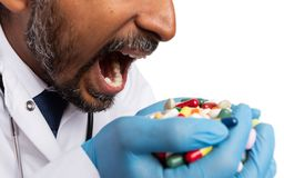 Close-up of hands full of drugs as medic takes them stock photos