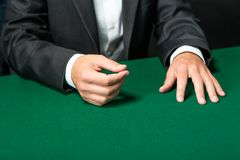 Close up of hands of gambler sitting at the poker table Stock Photos