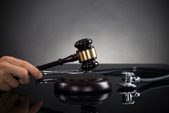 Close-up Of Hands With Gavel And Stethoscope Royalty Free Stock Image