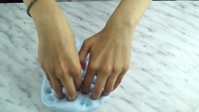 Hands of girl playing with slime. Close up on hands of girl playing with slime stock video footage