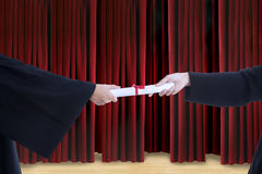 Close-up hands giving certificate on graduation day Stock Photography