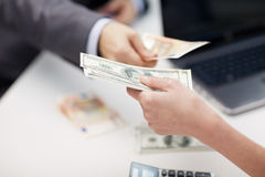 Close up of hands giving or exchanging money Royalty Free Stock Photography