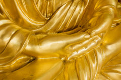 Close up hands of gold buddha statue Royalty Free Stock Images