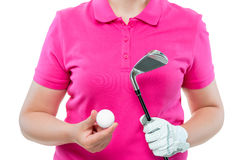 Close-up hands of a golfer with a ball and a club. In the studio on a white background Royalty Free Stock Photos