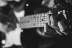 Close up of hands on guitar Royalty Free Stock Images