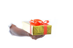 Close up of hands hold green gift box isolated on white background Stock Photos