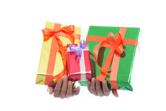 Close up of hands hold green gift box isolated on white background Stock Images