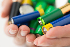 Close up of hands holding alkaline batteries heap Stock Image