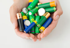 Close up of hands holding alkaline batteries heap Stock Photography