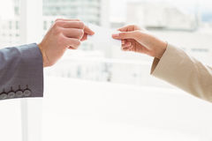 Close-up of hands holding business card Royalty Free Stock Images