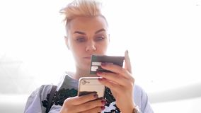 Close up hands holding credit card and using mobile smart phone indoor, Online shopping, woman happy. Close up hands holding credit card and using mobile smart stock video footage