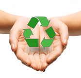 Close up of hands holding green recycling sign Royalty Free Stock Photos