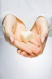 Close-up of hands holding heart. Close-up of hands holding candy heart Stock Images