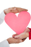 Close up of hands holding heart Stock Images