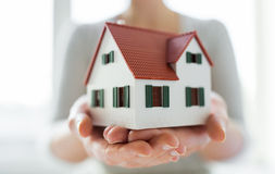 Close up of hands holding house or home model Royalty Free Stock Image