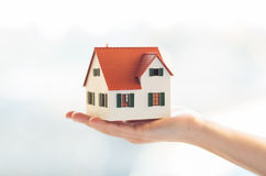 Close up of hands holding house or home model Royalty Free Stock Photography