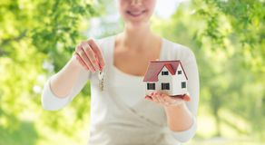 Close up of hands holding house model and keys royalty free stock photos