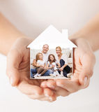 Close up of hands holding house shape with family Royalty Free Stock Photos
