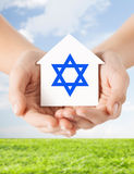Close up of hands holding house with star of david Royalty Free Stock Photography