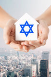 Close up of hands holding house with star of david Royalty Free Stock Image