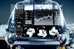 Touchscreen and finance concept. Close up of hands holding laptop with digital business interface hologram on blurry night city background. Touchscreen and stock images