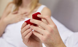 Close up of hands holding little red gift box Royalty Free Stock Photography