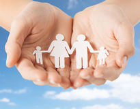 Close up of hands holding paper family pictogram Stock Images