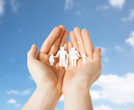 Close up of hands holding paper family pictogram Royalty Free Stock Photography