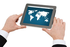Close up of hands holding tablet pc with world map Royalty Free Stock Photos