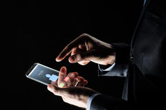 Close up of hands with incoming call on smartphone. Business, people and future technology concept - close up of businessman hands with incoming call on stock image