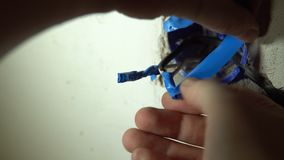 Close-up of hands isolate the soldered wires with blue electrical tape. Close-up of the electrician`s hand isolate the soldered wires with blue electrical tape stock video footage