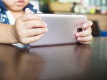 Close up of hands of the kids with the mobile phone royalty free stock photos