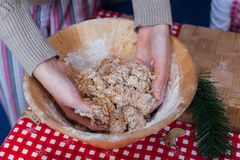 Close-up hands kneading dough for gingerbread at Stock Photo
