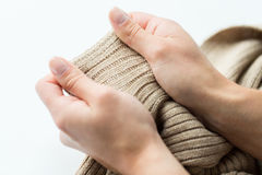 Close up of hands with knitted clothing item. Laundry, clothes, fashion, knitwear and people concept - close up of hands with knitted clothing item Stock Photography