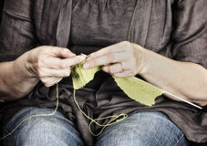 Close up of hands knitting Stock Images