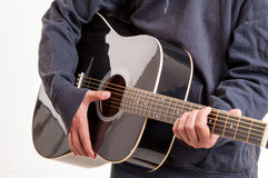 Close up, hands learning to playing an acoustic guitar Stock Images