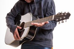 Close up, hands learning to playing an acoustic guitar Stock Photos