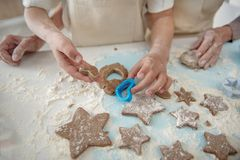 Friendly family sculpting form of cookies together Royalty Free Stock Photography