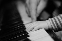 Close up hands of little girl playing piano, educational background Stock Photo