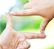 Close up of hands making frame gesture Royalty Free Stock Photo