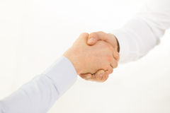 Close up of hands making handshake in office Stock Image