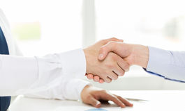 Close up of hands making handshake in office Stock Photography